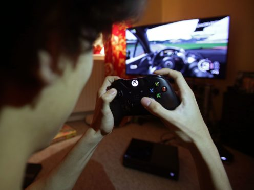 Playing video games has become a vital resource for young people to socialise with friends during the latest lockdown, according to new research (Yui Mok/PA)
