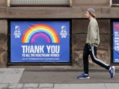 A pedestrian walks past a sign thanking the NHS in Nottingham city centre (Zac Goodwin/PA)