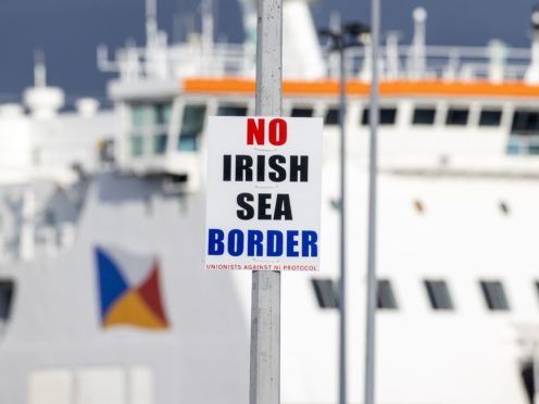 A sign on a lamp post outside Larne Port with the word 'No Irish Sea Border' (Liam McBurney/PA)