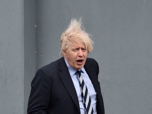Boris Johnson's former deputy at the Foreign Office has claimed the Prime Minister is an 'embarrassing buffoon' in a new book (Charles McQuillan/PA)