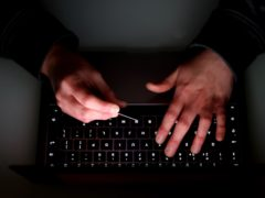 Nearly one in 10 people use own their name in their online passwords, ClearScore said (Tim Goode/PA)