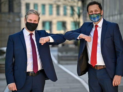 Sir Keir Starmer, left, and Scottish Labour leader Anas Sarwar have set out their plans to create thousands of jobs in Scotland (Jeff J Mitchell/PA)