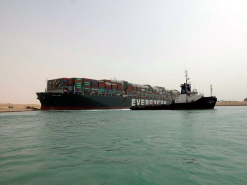 The Ever Given after it become wedged across the Suez Canal (Suez Cabal Authority/AP)