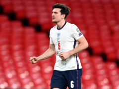 Harry Maguire has played in back threes as well as a four-man defence for England (Andy Rain/PA)