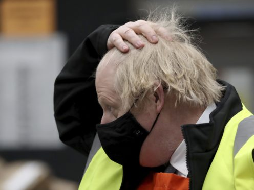 Prime Minister Boris Johnson during a visit to the B&Q store in Middlesbrough. Around two million of the UK's lowest-paid workers will receive a pay rise from Thursday with increases in statutory minimum wages. (Scott Heppell/PA)