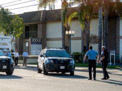 Officials work outside the scene of a shooting in Orange, California (Paul Bersebach/The Orange County Register via AP)