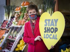 Nicola Sturgeon visits the Roots, Fruits and Flowers store in Glasgow's West End (Jane Barlow/PA)