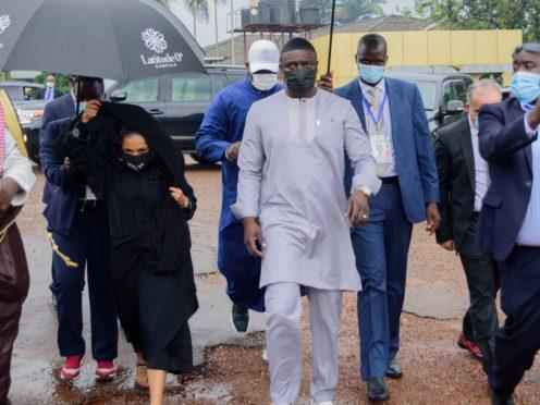Akon, right and his wife Rozina, arrive at the Gaddafi National Mosque in Kampala, Uganda (Nicholas Bamulanzeki/AP)