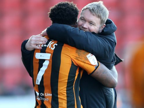 Hull manager Grant McCann celebrates victory at Crewe with match-winner Mallik Wilks (Barrington Coombs/PA)