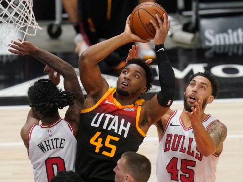 Utah Jazz guard Donovan Mitchell (45) goes to the basket as Chicago Bulls' Coby White (0) and Denzel Valentine (45) defend (Rick Bowmer/AP)