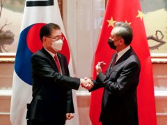 South Korean foreign minister Chung Eui-yong shakes hands with Chinese foreign minister Wang Yi (AP)