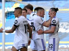 Jack Harrison, right, is congratulated by his Leeds team-mates after scoring in last week's home win against Sheffield United (Lindsey Parnaby/PA)