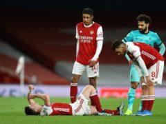 Kieran Tierney suffered knee ligament damage against Liverpool on Saturday (Julian Finney/PA)