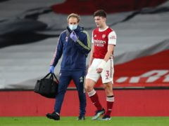 Kieran Tierney was forced off injured during Arsenal's Premier League loss to Liverpool (Catherine Ivill/PA)