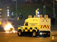 Police Service of Northern Ireland come under attack by Loyalists at the Cloughfern roundabout in Newtownabbey. Masked men threw petrol bombs and hijacked cars in the Loyalist area North of Belfast. (Peter Morrison/PA)