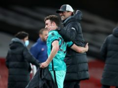 Diogo Jota (left) celebrates victory with manager Jurgen Klopp (Catherine Ivill/PA)