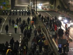 Demonstrators walk along the A4032 which leads to the M32 in Bristol during a 'Kill The Bill' protest (PA)