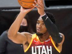 Utah Jazz guard Donovan Mitchell shoots a three-point basket against the Orlando Magic (Rick Bowmer/AP)