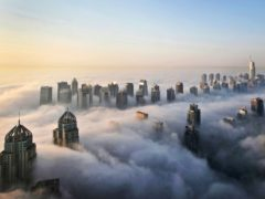 A thick blanket of early morning fog partially shrouds the skyscrapers of the Marina and Jumeirah Lake Towers districts of Dubai, United Arab Emirates (Kamran Jebreili/AP)