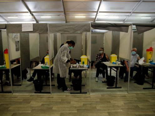 Patients receive Pfizer and Moderna's Covid-19 vaccine in a vaccination site in Sarcelles, outside Paris (AP/Christophe Ena)