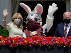 President Joe Biden appears with first lady Jill Biden and the Easter bunny on the Blue Room balcony at the White House (Evan Vucci/AP)