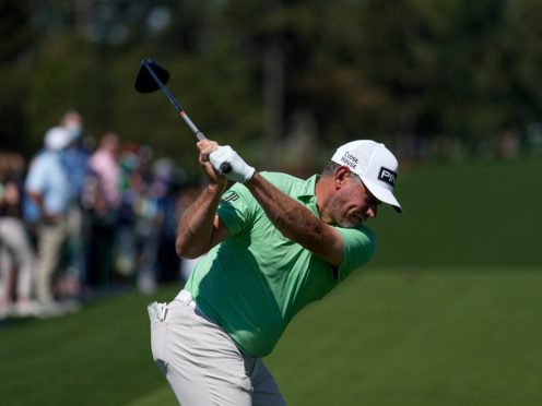 Lee Westwood hits his tee shot on the first hole during a practice round for the Masters (David J Phillip/AP)
