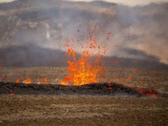 Steam and lava spurt from a new fissure on a volcano on the Reykjanes Peninsula in southwestern Iceland (Marco Di Marco/AP)