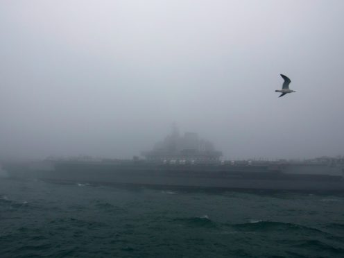 The Chinese People's Liberation Army (PLA) Navy aircraft carrier Liaoning (Mark Schiefelbein/AP)