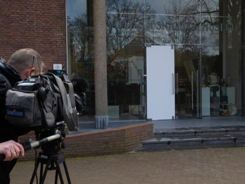 The glass door which was smashed during a break-in at the Singer Museum in Laren, Netherlands (Peter Dejong/AP)