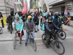 Deliveroo riders from the Independent Workers' Union of Great Britain in the City of London, as they go on strike (Stefan Rousseau/PA)