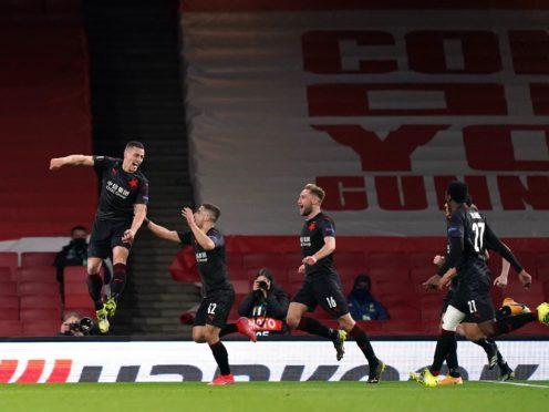 Tomas Holes celebrates scoring for Slavia Prague at Arsenal (John Walton/PA)