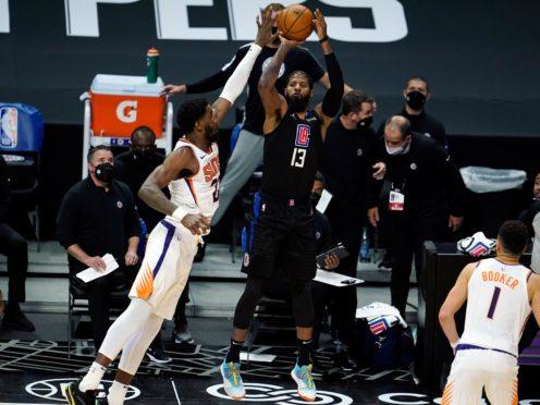 Los Angeles Clippers guard Paul George makes a 3-pointer (Marcio Jose Sanchez/AP)