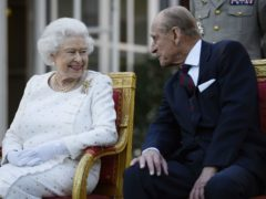 The Queen and the Duke of Edinburgh attending a garden party in Paris (Owen Humphreys/PA)