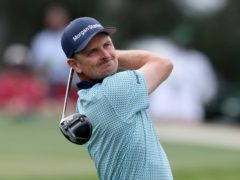 Justin Rose tees off on the third hole during the second round of the Masters golf tournament at Augusta National (Curtis Compton/Atlanta Journal-Constitution via AP)