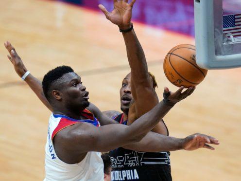 New Orleans Pelicans forward Zion Williamson drives to the basket against Philadelphia 76ers center Dwight Howard (Gerald Herbert/AP)