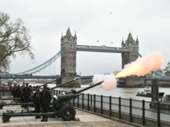 Members of the Honourable Artillery Company fire a 41-round gun salute from the wharf at the Tower of London (Dominic Lipinski/PA)