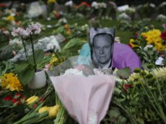 Floral tributes have been left outside Windsor Castle following the death of the Duke of Edinburgh (Steve Parsons/PA)