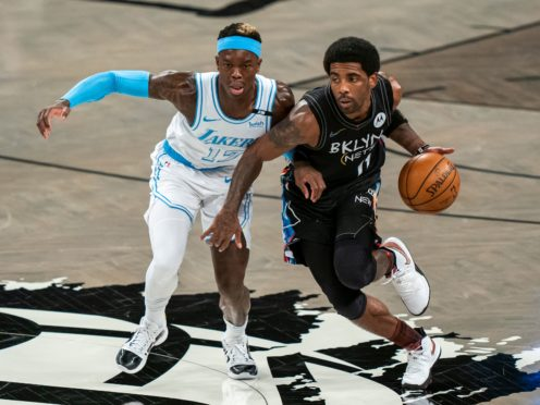 Los Angeles Lakers guard Dennis Schroder (17) defends against Brooklyn Nets guard Kyrie Irving (11) (Corey Sipkin/AP)