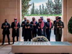 Jordan's King Abdullah II, centre, Prince Hamzah bin Al Hussein, second left, and others visit the tomb of the late King Hussein (Royal Court Twitter Account/AP)
