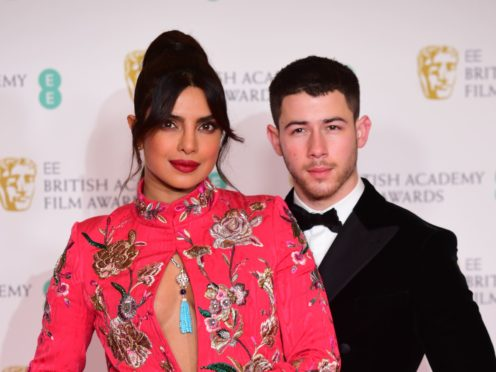 Priyanka Chopra Jonas and her husband Nick Jonas at the Baftas 2021 (Ian West/PA)