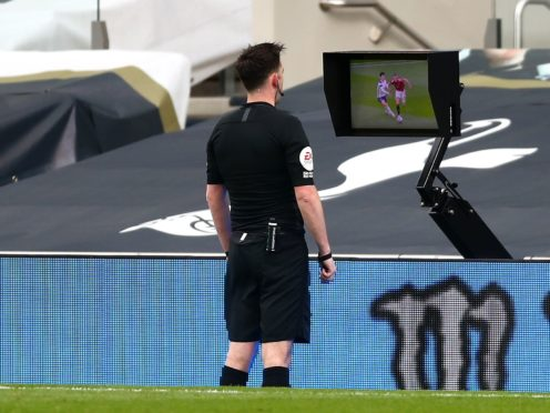 Referee Chris Kavanagh consults the pitchside monitor before ruling out Edinson Cavani's goal (Clive Rose/PA).