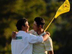Hideki Matsuyama hugs his caddie Shota Hayafuji after winning the Masters (David J Phillip/AP)
