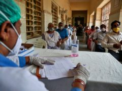 People wait for their turn to be administered Covishield vaccine at a government hospital in Hyderabad, India (Mahesh Kumar A/AP)