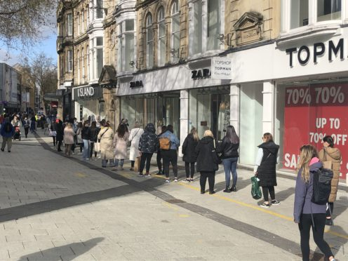 Shoppers in Cardiff. Nearly three-quarters (72%) of people said they had been able to make some savings on outgoings over the past 12 months, LV= said (Adam Hale/PA)