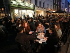 People gather for drinks and food in Soho, London, on the first night of pubs and restaurants reopening in England (Jonathan Brady/PA)