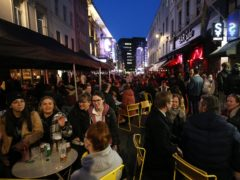 People gather for drinks and food in Old Compton Street, Soho, central London (Jonathan Brady/PA)