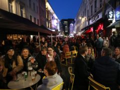 People gather for drinks and food in Old Compton Street, Soho (PA)
