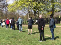 People queue for coronavirus surge testing on Clapham Common (Mike Bedigan/PA)