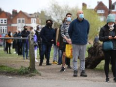 A queue for surge testing on Clapham Common (Kirsty O'Connor/PA)