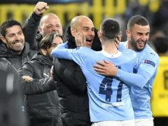 Manchester City manager Pep Guardiola celebrates with his players (PA via DPA)